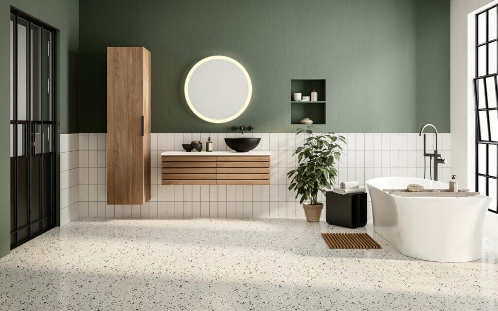 frittstående badekar i grønnmalt baderom med hvite fliser