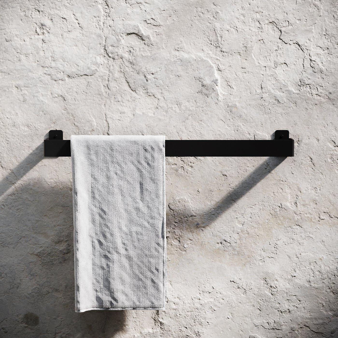 stang til å henge håndklær på festet på murvegg
